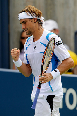 NEW YORK, NY - SEPTEMBER 04:  David Ferrer of Spain celebrates against Florian Mayer of Germany during Day Seven of the 2011 US Open at the USTA Billie Jean King National Tennis Center on September 4, 2011 in the Flushing neighborhood of the Queens boroug