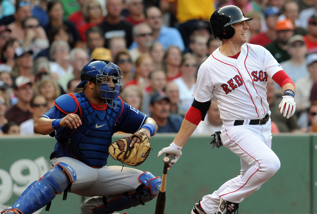 BOSTON, MA - SEPTEMBER 03: Jed Lowrie #12 of the Boston Red Sox swings at a pitch as catcher Yorvid Torrealba #8 of the Texas Rangers looks on in the third inning at Fenway Park on September 3, 2011 in Boston, Massachusetts. The Boston Red Sox won the gam