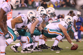 EAST RUTHERFORD, NJ - DECEMBER 12:  The Miami Dolphins offensive line against the New York Jets at New Meadowlands Stadium on December 12, 2010 in East Rutherford, New Jersey.  (Photo by Nick Laham/Getty Images)