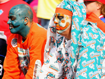 ORCHARD PARK, NY - SEPTEMBER 12: Miami Dolphins fans watch a play during the NFL season opener against the Buffalo Bills at Ralph Wilson Stadium on September 12, 2010 in Orchard Park, New York. The Dolphins won 15-10. (Photo by Rick Stewart/Getty Images)