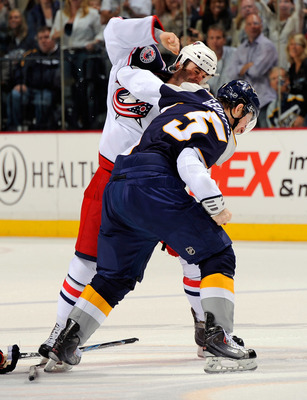NASHVILLE, TN - APRIL 08:  Derek MacKenzie #24 of the Columbus Blue Jackets fights Blake Geoffrion #5 of the Nashville Predators on April 8, 2011 at the Bridgestone Arena in Nashville, Tennessee.  (Photo by Frederick Breedon/Getty Images)