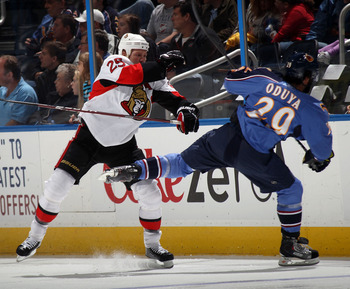 ATLANTA, GA - MARCH 27: Chris Neil #25 of the Ottawa Senators hits Johnny Oduya #29 of the Atlanta Thrashers at the Philips Arena on March 27, 2011 in Atlanta, Georgia.  (Photo by Bruce Bennett/Getty Images)