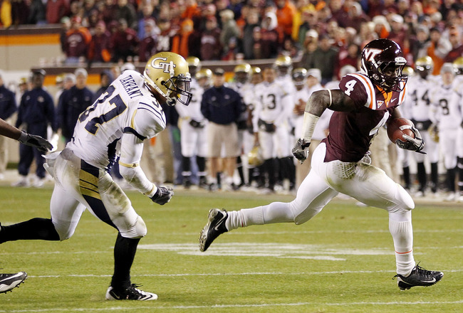 BLACKSBURG, VA - NOVEMBER 04: Running back David Wilson #4 of the Virginia Tech Hokies runs with the ball past cornerback Jerrard Tarrant #37 of the Georgia Tech Yellow Jackets to score a touchdown at Lane Stadium on November 4, 2010 in Blacksburg, Virgin