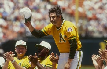 OAKLAND,CA - 1991: Retired pitcher Rollie Fingers of the Oakland Athletics waves after being introduced before the Old Timers game in the 1991 season at Oakland-Alameda County Coliseum  in Oakland,California. (Photo by: Otto Greule Jr/Getty Images)