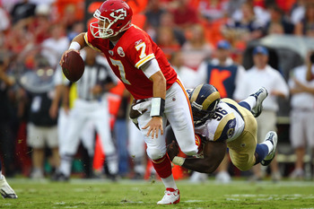 KANSAS CITY, MO - AUGUST 26: Matt Cassel #7 of the Kansas City Chiefs is sacked by James Hall #96 of the St. Louis Rams during a pre-season game at Arrowhead Stadium  on August 26, 2011 in Kansas City, Missouri.  (Photo by Dilip Vishwanat/Getty Images)