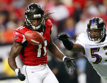 ATLANTA, GA - SEPTEMBER 01:  Julio Jones #11 of the Atlanta Falcons pulls in this reception against  Jameel McClain #53 of the Baltimore Ravens at Georgia Dome on September 1, 2011 in Atlanta, Georgia.  (Photo by Kevin C. Cox/Getty Images)