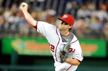 WASHINGTON, DC - AUGUST 01:  Drew Storen #22 of the Washington Nationals pitches against the Atlanta Braves at Nationals Park on August 1, 2011 in Washington, DC. The Nationals won the game 5-3. (Photo by Greg Fiume/Getty Images)