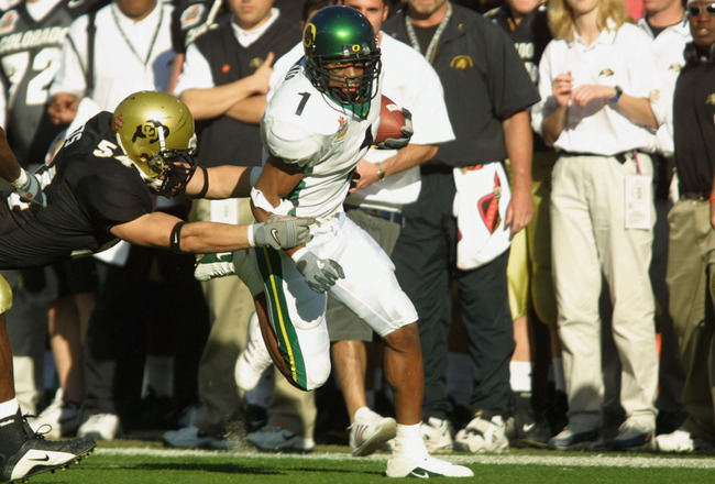 01 Jan 2002 : Samie Parker #1 of Oregon is chased by Sean Tufts #54 of Colorado during the game at the  Fiesta Bowl at Sun Devil Stadium in Tempe, Arizona. The Oregon Ducks won 38-16. DIGITAL IMAGE. Mandatory Credit: Jeff Gross/Getty Images