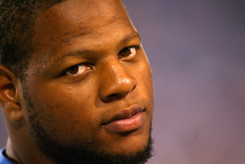 ORCHARD PARK, NY - SEPTEMBER 01:  Ndamukong Suh #90 of the Detroit Lions sits on the sidelines against the Buffalo Bills at Ralph Wilson Stadium on September 1, 2011 in Orchard Park, New York.  Detroit won 18-6.(Photo by Rick Stewart/Getty Images)
