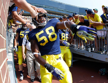 ANN ARBOR, MI - SEPTEMBER 03: Brandon Herron #58 of the Michigan Wolverines runs onto the field prior to playing the Western Michigan Broncos at Michigan Stadium on September 3, 2010 in Ann Arbor, Michigan. (Photo by Gregory Shamus/Getty Images)