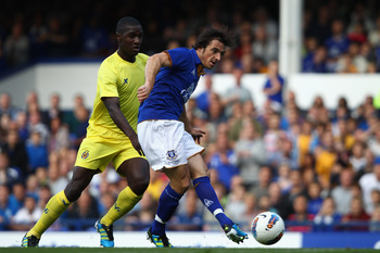 LIVERPOOL, ENGLAND - AUGUST 05: Leighton Baines of Everton in action with Zapata of Villarreal during the pre season friendly match between Everton and Villarreal  at Goodison Park on August 5, 2011 in Liverpool, England.  (Photo by Clive Brunskill/Getty