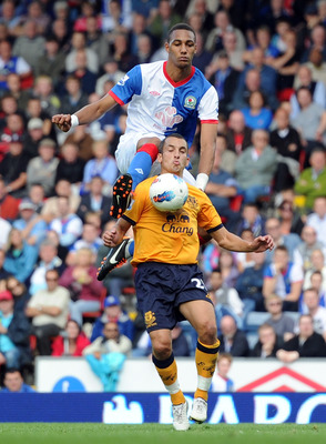 BLACKBURN, ENGLAND - AUGUST 27:  Steven Nzonzi of Blackburn Rovers challenges Leon Osman of Everton during the Barclays Premier League match between Blackburn Rovers and Everton at Ewood Park on August 27, 2011 in Blackburn, England.  (Photo by Chris Brun