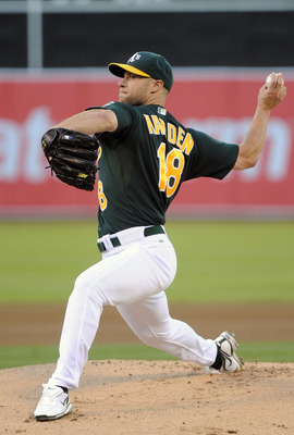 OAKLAND, CA -  JULY 1:  Rich Harden #18 of the Oakland Athletics pitches against the Arizona Diamondbacks in the first inning during a MLB baseball game July 1, 2011 at the Oakland-Alameda County Coliseum in Oakland, California. (Photo by Thearon W. Hende