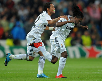 MADRID, SPAIN - OCTOBER 21:  Royston Drenthe (R) of Real Madrid celebrates scoring his side equalizing goal with his teammate Marcelo Vieira during the Champions League group C match between Real Madrid and AC Milan at the Estadio Santiago Bernabeu on Oct