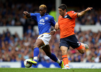 LIVERPOOL, ENGLAND - AUGUST 20:  Bradley Orr of Queens Park Rangers competes with Louis Saha of Everton during the Barclays Premier League match between Everton and Queens Park Rangers at Goodison Park on August 20, 2011 in Liverpool, England.  (Photo by