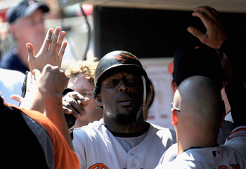 MINNEAPOLIS, MN - AUGUST 25: Vladimir Guerrero #27 of the Baltimore Orioles celebrates scoring on a Mark Reynolds' home run in the seventh inning against the Minnesota Twins on August 25, 2011 at Target Field in Minneapolis, Minnesota. The Orioles defeate