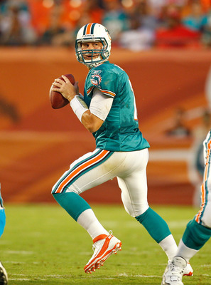 MIAMI GARDENS, FL - AUGUST 19:  Chad Henne #7 of the Miami Dolphins drops back during a preseason NFL game against the Carolina Panthers at Sun Life Stadium on August 19, 2011 in Miami Gardens, Florida.  (Photo by Mike Ehrmann/Getty Images)