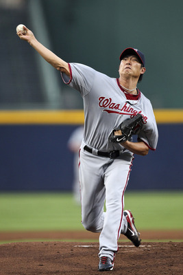 ATLANTA, GA - SEPTEMBER 1: Chien-Ming Wang #40 of the Washington Nationals pitches in the first inning of the game against the Atlanta Braves at Turner Field on September 1, 2011 in Atlanta, Georgia. (Photo by Daniel Shirey/Getty Images)