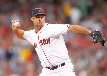 BOSTON, MA - AUGUST 3:  Tim Wakefield #49 of the Boston Red Sox throws against the Cleveland Indians at Fenway Park on August 3, 2011 in Boston, Massachusetts.  Wakefield is attempting to earnhis 200 win with the Red Sox. (Photo by Jim Rogash/Getty Images