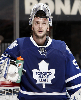 TORONTO, CANADA - JANUARY 6: Jonas Gustavsson #50 of the Toronto Maple Leafs reacts to the 5th goal scored by the St. Louis Blues during game action at the Air Canada Centre January 6, 2011 in Toronto, Ontario, Canada. (Photo by Abelimages/Getty Images)