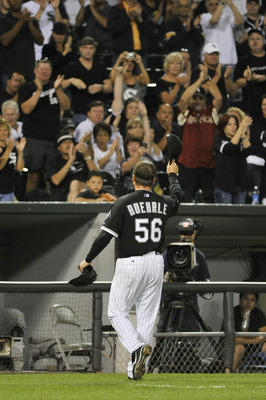 CHICAGO, IL - AUGUST 29:  Starting pitcher Mark Buehrle #56 of the Chicago White Sox tips his hat to the crowd after being taken out of the game in the eighth inning against the Minnesota Twins at U.S. Cellular Field on August 29, 2011 in Chicago, Illinoi