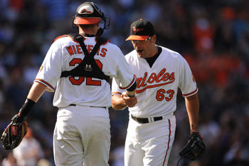 BALTIMORE, MD - AUGUST 28:  Kevin Gregg #63  and Matt Wieters #32 of the Baltimore Orioles celebrate after a baseball game against the New York Yankees at Oriole Park at Camden Yards on August 28, 2011 in Baltimore, Maryland.  The Orioles won 2-0.  (Photo