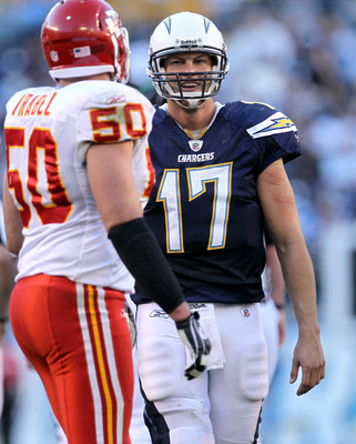 SAN DIEGO - DECEMBER 12:  Quarterback Philip Rivers #17 of the San Diego Chargers laughs as he talks to linebacker Mike Vrabel #50 of the Kansas City Chiefs at Qualcomm Stadium on December 12, 2010 in San Diego, California.  the Chargers won 31-0.  (Photo