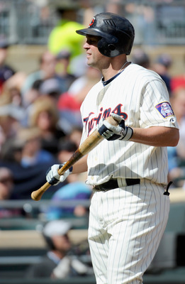 MINNEAPOLIS, MN - SEPTEMBER 5: Michael Cuddyer #5 of the Minnesota Twins reacts to striking out against the Chicago White Sox in the sixth inning of game one of a doubleheader on September 5, 2011 at Target Field in Minneapolis, Minnesota. White Sox defea