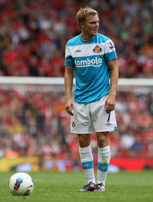 LIVERPOOL, ENGLAND - AUGUST 13:  Sebastian Larsson of Sunderland prepares to take a free kick during the Barclays Premier League match between Liverpool and Sunderland at Anfield on August 13, 2011 in Liverpool, England.  (Photo by Clive Brunskill/Getty I