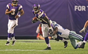MINNEAPOLIS, MN - AUGUST 27: Adrian Peterson #28 of the Minnesota Vikings advances the ball against Abram Elam #24 of the Dallas Cowboys during their pre-season match at Mall of America Field on August 27, 2011 in Minneapolis, MN.  (Photo by Adam Bettcher