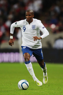 LONDON, ENGLAND - SEPTEMBER 06:  Ashley Young of England runs with the ball during the UEFA EURO 2012 group G qualifying match between England and Wales at Wembley Stadium  on September 6, 2011 in London, England.  (Photo by Ross Kinnaird/Getty Images)