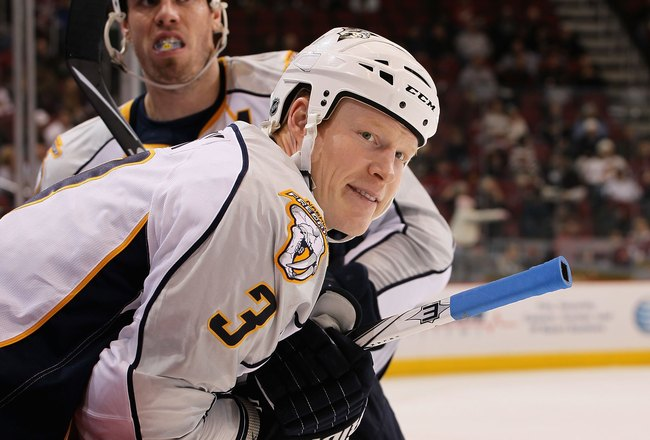 GLENDALE, AZ - JANUARY 21:  Wade Belak #3 of the Nashville Predators looks on from the bench during the NHL game against the Phoenix Coyotes at Jobing.com Arena on January 21, 2010 in Glendale, Arizona.   The Coyotes defeated the Predators 4-2.  (Photo by
