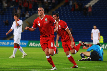 CARDIFF, WALES - SEPTEMBER 02:  Steve Morison (C) of Wales celebrates scoring during the UEFA EURO 2012 group G qualifying match between Wales and Montenegro at the Cardiff City Stadium on September 2, 2011 in Cardiff, Wales.  (Photo by Paul Gilham/Getty