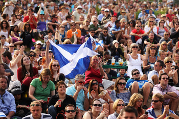 LONDON, ENGLAND - JUNE 29:  Tennis spectators wave a Scotland flag while watching Andy Murray's quarter final match against Feliciano Lopez of Spain on Day Nine of the Wimbledon Lawn Tennis Championships at the All England Lawn Tennis and Croquet Club on