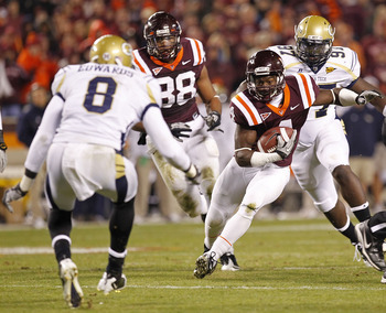 BLACKSBURG, VA - NOVEMBER 04: Running back David Wilson #4 of the Virginia Tech Hokies rujns with the ball in front of cornerback Mario Edwards #8 of the Georgia Tech Yellow Jackets at Lane Stadium on November 4, 2010 in Blacksburg, Virginia.  (Photo by G