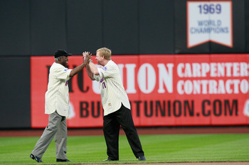 NEW YORK - AUGUST 22:  Ed Charles high fives Wayne Garrett during the presentation commemorating the New York Mets 40th anniversary of the 1969 World Championship team on August 22, 2009 at Citi Field in the Flushing neighborhood of the Queens borough of