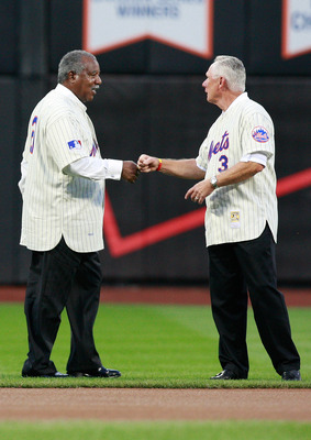 NEW YORK - AUGUST 22: Cleon Jones bumps fists with Bud Harrelson during the presentation commemorating the New York Mets 40th anniversary of the 1969 World Championship team on August 22, 2009 at Citi Field in the Flushing neighborhood of the Queens borou