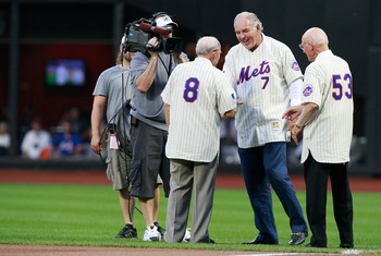 NEW YORK - AUGUST 22:  Ed Kranepool shakes hands with Yogi Berra and Ed Yost during the presentation commemorating the New York Mets 40th anniversary of the 1969 World Championship team on August 22, 2009 at Citi Field in the Flushing neighborhood of the