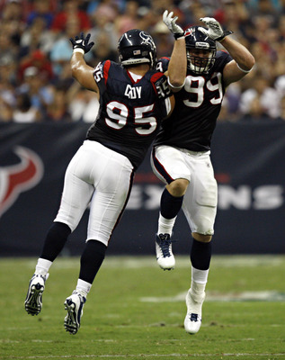 HOUSTON - AUGUST 20:  Defensive end J.J. Watt #99 of the Houston Texans celebrates with defensive end Shaun Cody #95 after knocking down a pass during a pre-season football game against the New Orleans Saints at Reliant Stadium on August 20, 2011 in Houst