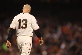 SAN FRANCISCO, CA - AUGUST 25:  Cody Ross #13 of the San Francisco Giants looks on after striking out against the Houston Astros at AT&amp;T Park on August 25, 2011 in San Francisco, California.  (Photo by Jed Jacobsohn/Getty Images)