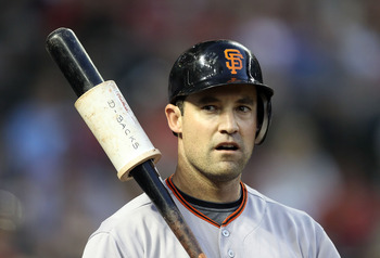PHOENIX, AZ - JUNE 15:  Pat Burrell #5 of the San Francisco Giants warms up on deck during the Major League Baseball game against the Arizona Diamondbacks at Chase Field on June 15, 2011 in Phoenix, Arizona. The Giants defeated the Diamondbacks 5-2.  (Pho