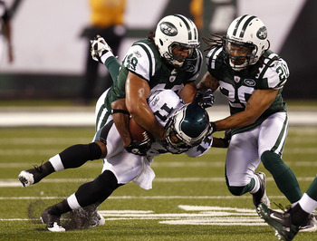 EAST RUTHERFORD, NJ - SEPTEMBER 01:  Kyle Wilson #20 and  Brashton Satele #48 of the New York Jets take down  Sinorice Moss #11 of the Philadelphia Eagles during their pre-season game at MetLife Stadium on September 1, 2011 in East Rutherford, New Jersey.