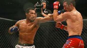 Ronaldo Souza landing a stiff jab on Tim Kennedy