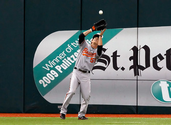 ST. PETERSBURG, FL - SEPTEMBER 04:  Outfielder Kyle Hudson #51 of the Baltimore Orioles catches a fly ball against the Tampa Bay Rays during the game at Tropicana Field on September 4, 2011 in St. Petersburg, Florida.  (Photo by J. Meric/Getty Images)