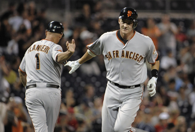 SAN DIEGO, CA - SEPTEMBER 6:  Brett Pill #6 of the San Francisco Giants is congratulated by Tim Flannery #1 after hitting a two-run homer during the second inning of a baseball game against the San Diego Padres at Petco Park on September 6, 2011 in San Di