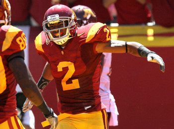 LOS ANGELES, CA - SEPTEMBER 03:  Wide receiver Robert Woods #2 of the USC Trojans celebrates after making a 43 yard touchdown reception against the Minnesota Golden Gophers in the second quarter at the Los Angeles Memorial Coliseum on September 3, 2011 in