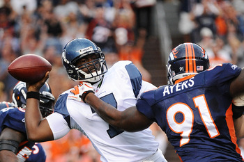 DENVER, CO - AUGUST 27:  Robert Ayers #91 of the Denver Broncos hits Tavaris Jackson #7 of the Seattle Seahawks as he throws a pass during the preseason game at Sports Authority Field at Mile High on August 27, 2011 in Denver, Colorado.  (Photo by Garrett