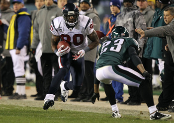 PHILADELPHIA, PA - DECEMBER 02:  Andre Johnson #80 of the Houston Texans runs for yards after the catch in the second half against Dimitri Patterson #23 of the Philadelphia Eagles at Lincoln Financial Field on December 2, 2010 in Philadelphia, Pennsylvani