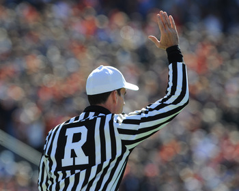 AUBURN, AL - NOVEMBER 06:  NCAA referee Ken Williamson signals the start of play as the Auburn Tigers play against the Chattanooga Mocs November 6, 2010 at Jordan-Hare Stadium in Auburn, Alabama.  (Photo by Al Messerschmidt/Getty Images)
