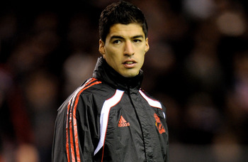 LIVERPOOL, ENGLAND - FEBRUARY 02:  New Liverpool signing Luis Suarez looks on prior to the Barclays Premier League match between Liverpool and Stoke City at Anfield on February 2, 2011 in Liverpool, England.  (Photo by Michael Regan/Getty Images)